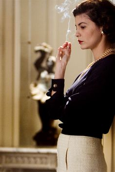 """nature-and-culture: """"Coco Before Chanel (French: Coco avant Chanel) is a 2009 biographical drama film directed and co-written by Anne Fontaine. The film stars Audrey Tautou and details the early life of French fashion designer Coco Chanel. Audrey Tautou, Women Smoking, Girl Smoking, Catherine Deneuve, Jean Claude Pascal, Estilo Coco Chanel, Mademoiselle Coco, Jean Gabin, Movies"""