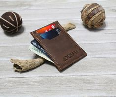 Mens Leather wallet, Mens Wallet, Leather Wallet, Minimal Leather Wallet, thin leather wallet > Slim fit design > Handcrafted > 3.25 by 4.50 > Full Grain Vegetable Tanned Distressed Leather, Brown color > 3 cards Pockets. (there are 3 pockets and each can hold two cards comfortably)