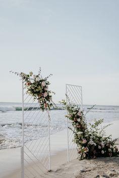 modern floral arbour for a beach wedding
