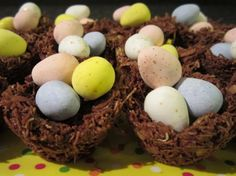 Chocolate Robin's Nests ~ Great recipe for the kids to make. Only need four ingredients: coconut, shredded wheat (the big loaves), milk chocolate chips, and mini Cadbury eggs. Yummy! :0)