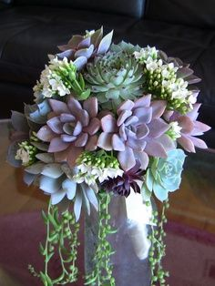 Succulent bouquet -Can be prepared well ahead of the wedding date and planted afterwards