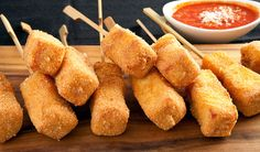 The Best Cheese Sticks - Smoked Mozzarella, Emmental, Ham, and bread crumbs come together to make the best cheese sticks - By Stefano Faita at www.cbc.ca #Cheese #Sticks #Appetizer #Food