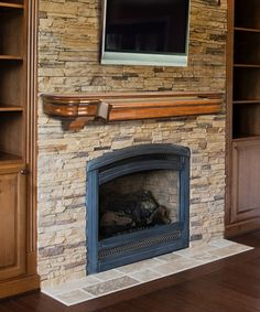 image of inspiring custom wood fireplace mantel shelf adhere on stacked stone fireplace veneer under wall mount 32 samsung lcd tv alongside travertine tiles for fireplace hearth also corner electric fireplace tv stand gas fireplace pilot kit increase gas fireplace flame ashley furniture electric fireplace corner gas fireplace designs
