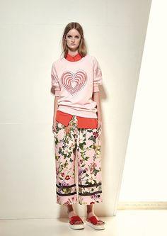 Model wears Naughty Dog SS17 heart sweatshirt combined with flowers & butterflies midi pants