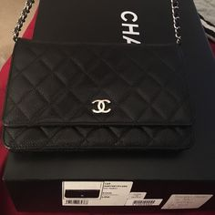 Authentic CHANEL wallet on a chain Black quilted leather with sliver hard ware 3pockets on the inside 1 on the back of the bag 6 credit card slots .... No boxNo card just dust bag wiling to negotiate no low ball offers CHANEL Bags Wallets