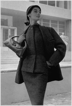 Jacky Mazel in slim wool suit topped with an ample jacket, Winter 1954-55