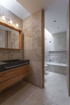 If you wish to add a bathroom in your house but possess a limited budget, mind for that basement. Small Basement Bathroom, Add A Bathroom, Modern Bathroom, Contemporary Country Home, Travertine Bathroom, Washroom Design, Shower Niche, House Front Design, Minimalist Architecture