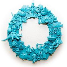 recycled toy wreath-good idea for all those broken Xmas ornaments. Wud be cool to spray paint you in shadow box also for a look and find