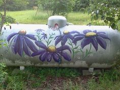 No more ugly propane tank. Outdoor Projects, Garden Projects, Outdoor Decor, Propane Tank Art, Fresco, Farm Art, Fence Art, Tank Design, Diy Projects To Try
