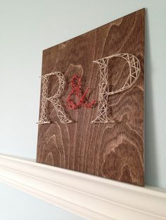 DIY string art is easy to make and is a great way to display the couple's initials at a wedding reception. Pricilla Chang shows you the steps to create this string art project. || @changcilla