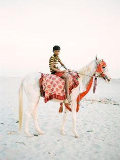 Taken on the Eastern bank of the Ganges river at Varanasi this photo is of a young boy on a sacred Marwari dancing horse. It was shot just as the last rays of the sun were about to disappear below the horizon.