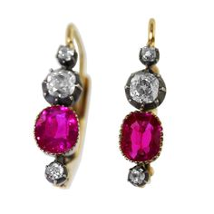 """Burma Ruby Diamond Silver-Topped Gold Earrings. A beautiful pair of silver-topped 18 karat yellow gold, ruby and diamond earrings, set with 2 well-matched cushion-shaped rubies weighing approximately 1.90 carats, Burma no heat, and 6 old mine-cut diamonds weighing approximately 0.45 carat, gross weight 3.2 grams, measuring 3/4"""" long, earring backs later added to antique elements. Late 19th century."""