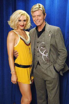 September 8, 2005 - There's no doubt that Gwen Stefani was stoked to be posing with an open-necked but still stylish (and healthy looking) Bowie during the Fashion Rocks event at New York's Radio City Music Hall.