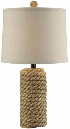 The Rustic Rope Lamp stands 25.5 inches tall and is hand crafted in all natural rattan, with a rope like finish. Complimented by a beach-rustic burlap shade and matching matching rattan finial.