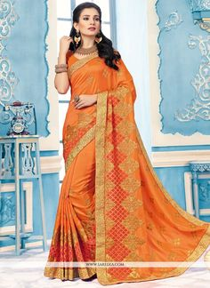 An exceptional orange crepe silk classic designer saree will make you appear extremely stylish and graceful. The ethnic embroidered and patch border work with a attire adds a sign of splendor statemen...