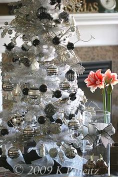 Nice White Flocked Christmas Tree With Black And Silver Ornaments