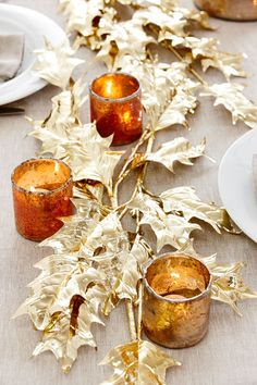 Use Holly branches and spray paint in fall or christmas colors for table decor