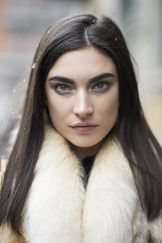 Bold brows and pin-straight hair made a striking look on model | Beauty Street Style: View the Chicest Darlings of Milan Fashion Week | POPSUGAR Beauty