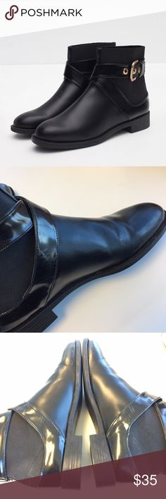 Zara black buckle boots Ankle boots. I'm a clumsy walker so there are scuffs on sides of the shoe. Other that, I've only worn them a small handful of times. The ankle part is a stretchy material and has a x patter buckle. Fits a size 7. They're a size 38 Zara Shoes Ankle Boots & Booties