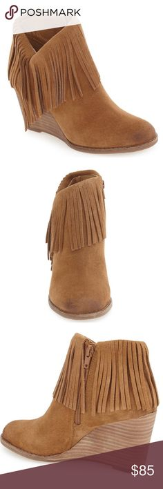 """🆕 Lucky Brand Honey Suede Yachin Wedge Bootie Strike a stylish pose in this captivating bootie in that perfect honey shade that goes with so many boho looks. This darling oiled suede bootie sports a stacked wedge heel and is finished out in fierce fringe. BRAND NEW IN ORIGINAL BOX DIRECTLY FROM LUCKY WAREHOUSE.   ☀️ 3"""" heel ☀️ 3 1/2"""" shaft ☀️ Side zip closure ☀️ Leather upper/synthetic lining and sole Lucky Brand Shoes Ankle Boots & Booties"""