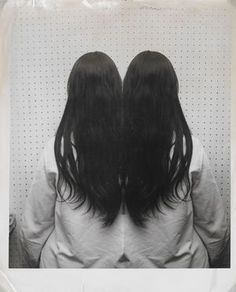 "Weegee (American, 1899-1968), ""Girl with Long Black Hair, Mirror Image,"" no date; Indianapolis Museum of Art, Caroline Marmon Fesler Fund, Gift of the Alliance of the Indianapolis Museum of Art, Roger G. Wolcott Fund, Nancy Foxwell Neuberger Acquisition Endowment Fund, Mr. and Mrs. Theodore P. Van Vorhees Art Fund, Cecil F. Head Art Fund, James V. Sweetser Fund, 2009.237; © Weegee/International Center of Photography/Getty Images."