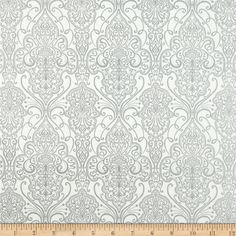 Designed by Studioe Fabrics, this cotton print fabric is perfect for quilting, apparel and home decor accents. Features silver metallic accents throughout.