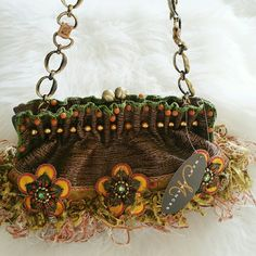 """💞SALE💞 🎉HP🎉 Mary Frances Stunning Bag Gorgeous Authentic NWT One of a Kind  Mary Frances Bag. This is a Beautiful Bag with Stunning Crystals, Feathers, Beading and Detailing. This Bag will turn heads.. Brand New purchased at Boutique in Pacific Palasades. 14"""" W x 7"""" H. Inside pockets and Adorable Lining. Perfect Gift for that Loved one a Treat Yourself to this Special Bag. Mary Frances Bags"""