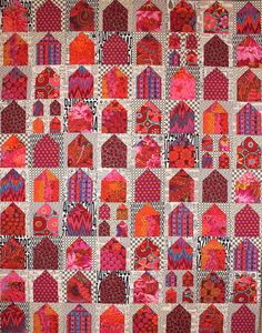 Kit features fabrics similar to our quilt, with Kaffe Fassett prints for the houses and various black/white prints for the backgrounds (including fabrics