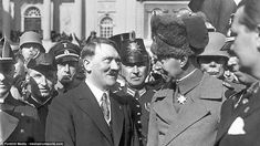 Cosying up: Crown Prince William and Adolf Hitler in front of the garrison church, Potsdam...