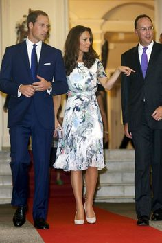 September 13 2012    At a British gala reception, she wore an Erdem printed dress and carried a lilac box clutch.