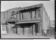 """According to the USC Digitial Archive, this dwelling on Juan Street in old Chinatown had a reputation for being haunted in 1933. Note the """"For Rent"""" sign next to the door.  Bizarre Los Angeles."""