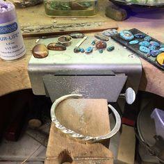 @mokshacreative Twisted forged cuff ready for finishing. #riojeweler #silversmith #metalsmith #onthebench