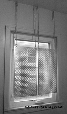 DIY Metal Curtain Panels! Gives privacy while allowing plenty of light. Looks modern and industrial!
