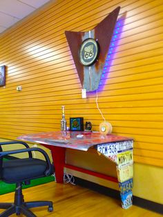 Car parts office desk - love the bright orange and yellow backdrop. Shared by www.highroadorganizers.com