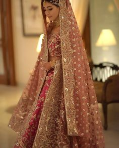 This is probably one of the most beautiful bridal outfits we've seen. We'… This is probably one of the most beautiful bridal outfits we've seen. We're obsessing over the colour combination and that subtle yet glam… Golden Bridal Lehenga, Indian Bridal Lehenga, Pakistani Bridal Dresses, Indian Dresses, Wedding Lehnga, Desi Wedding, Indian Clothes, Wedding Wear, Walima Dress