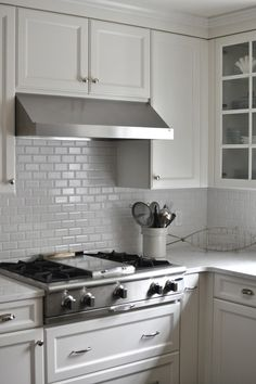 Minimalist White Tile Backsplash and White Cabinets in the Traditional Kitchen with White Cambria Quartz Countertops
