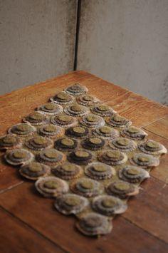 Wool penny rug by primitivespast.com