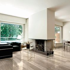 The shiny luxury of a porcelain tile with nature-derivated chromatic design. At our tile store in nj Fossil Wood is just one of the many porcelain tile ideas that you will find Living Room With Fireplace, Home Living Room, Living Room Designs, Floor Design, Tile Design, Fossil, Fireplace Pictures, Wood Look Tile, Tile Installation