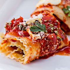 These pizza lasagna rolls will rock you to pizza heaven without the crunch of the crust.