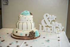 Turquoise and brown themed 3 tier wedding cake.