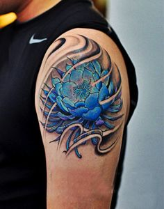 Bright blue lotus flower tattoo - I guess both men and women, straight or gay can wear this design. It looks absolutely stunning . #TattooModels #tattoo
