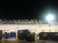 from Chris Clark ‏@Cdclarksports   Might be some empty seats in the stands but it's standing room only on top of the garages at Daytona #wcnc