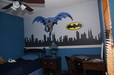 This is my son's new 'Batman' room.  The cityscape is from www.wallsneedlove.com, the Batman is from Pottery Barn Kids and the Batman Logo is from www.newsigns.com.  I painted the walls blue and grey, added the chair rail trim to sit Batman figures on and put up the decals, it came out great and he loves it!
