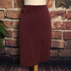 "Maroon stretch fitted pencil skirt Adorable & comfy. Has a few small unnoticeable stains. Price reflects. Stretchy waistband, can fit a few sizes. (Sized as 16 girls, fits small best) hits right below the knees on someone 5'2"". Skirts Pencil"