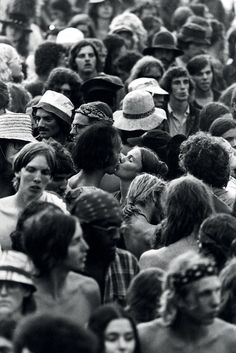 """Watkins Glen, New York / July 28, 1973 A young couple kisses as the chaos of the crowd whirs around them with an estimated 600,000 rock fans. The Summer Jam at Watkins Glen was a 1973 rock festival which once received the Guinness Book of World Records entry for """"Largest audience at a pop festival."""""""