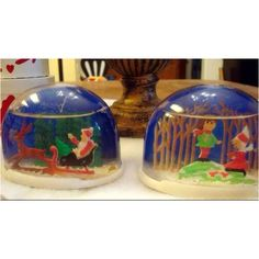 Snow globes. Ours looked more like these.. than the fancy, heavy ones we have today.
