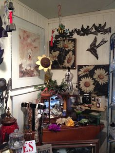 Jewelry, prints, paintings, tables,chairs, french soaps, little quilts and matching pillows, used cowboy/girl boots , vintage jackets, vases, evening bags and purses,dishes,the list goes on and on!  Come check us out!  www.tollenfarm.com