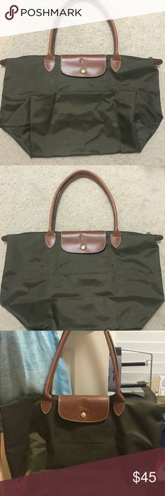 AUTHENTIC LONGCHAMP LE PLIAGE TOTE Evergreen nylon tote bag with leather handles, button closer and black interior. The large shopping style size. Used condition, no odor or stains. Interior in excellent condition Longchamp Bags Totes
