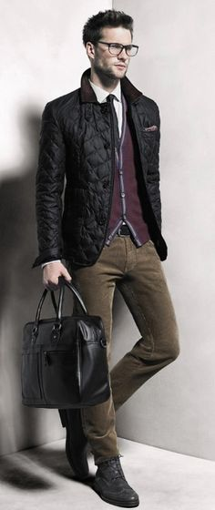 Black Quilted Nylon Jacket, Sweater Vest, Corduroy Jeans, Leather Duffle Bag. Men's Fall Winter Fashion.