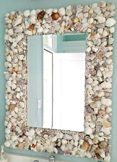 Make a Seashell Mirror: http://www.completely-coastal.com/2013/03/seashell-mirror-ideas.html Gorgeous seashell mirror made with shells from beach vacation..., glued on a wide plank frame.
